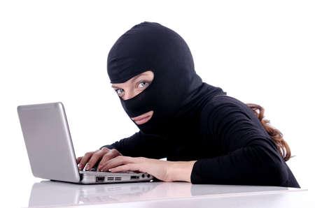 Hacker with computer wearing balaclava Stock Photo - 18232058