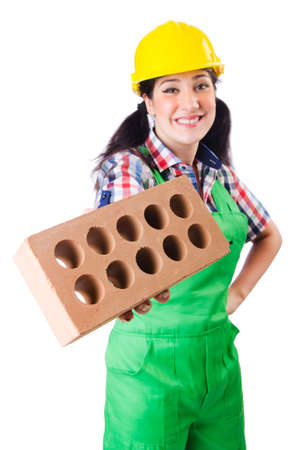 Woman builder with bricks on white Stock Photo - 18636603