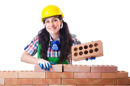 Woman builder with bricks on white Stock Photo - 18655713