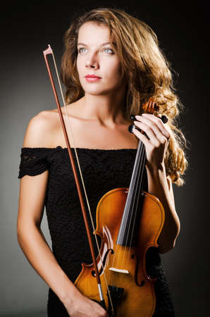 Woman performer with violin in studio Stock Photo - 18654826