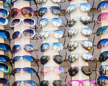 Many sunglasses on display in shop photo