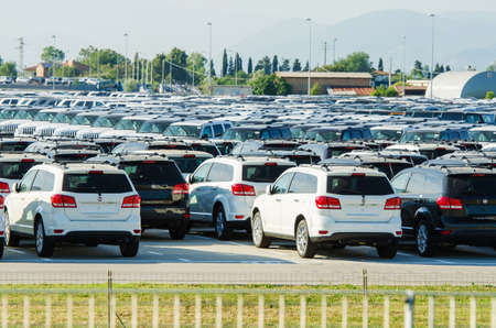 new car lot: TUSCANY, ITALY - 27 June: New cars parked at distribution center in Tuscany, Italy. This one of biggest distribution centers in Italy.