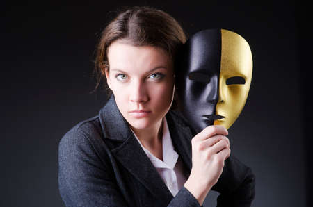 Woman with mask in hypocrisy concept Stock Photo - 18663059