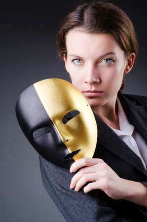 Woman with mask in hypocrisy concept Stock Photo - 18663066