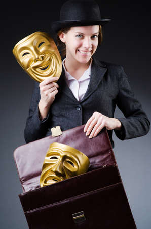 Woman with mask in hypocrisy concept Stock Photo - 18663058