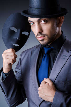 Man with black mask in studio Stock Photo - 18663072