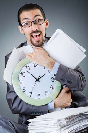 Man with clock and pile of papers Stock Photo - 18663922