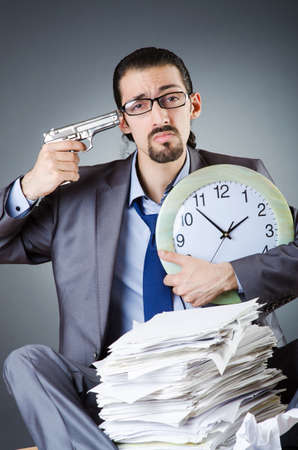 Man with clock and pile of papers Stock Photo - 18663926