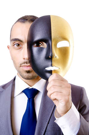 Businessman with mask in hypocrisy concept Stock Photo - 18663929