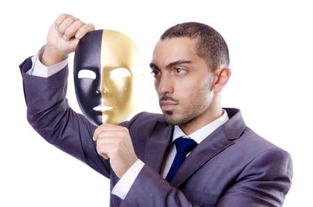 hipocresía: Hombre de negocios con la m�scara de hipocres�a en concepto Foto de archivo
