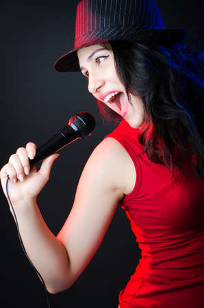 Female performer at disco with mic photo