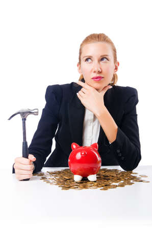 Woman breaking piggy bank for savings Stock Photo - 18663586