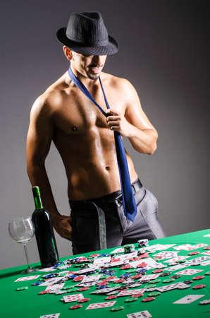 holdem: shirtless broke businessman in casino Stock Photo