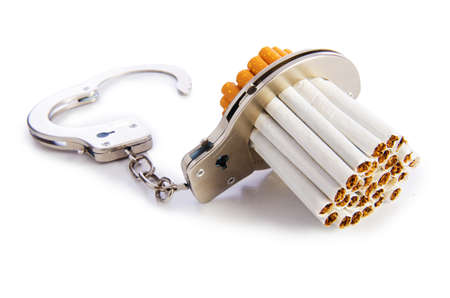 Addition concept with cigarettes and handcuffs photo