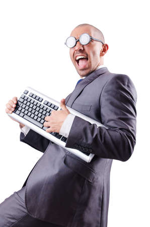 Nerd businessman with computer keyboard on white photo