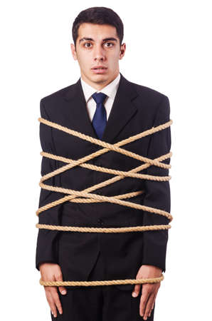 Businessman tied up with rope on white photo