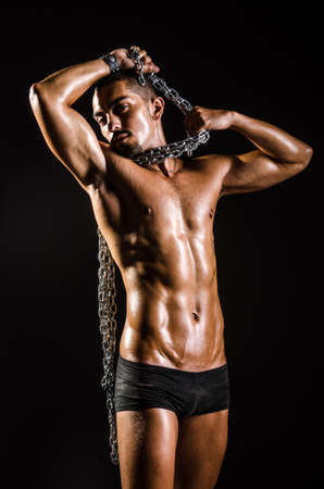 Muscular man with chain on black background Stock Photo - 18663878