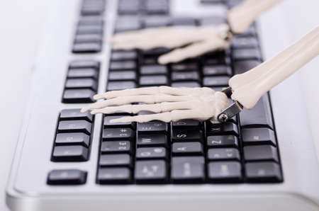Skeleton working on the keyboard Stock Photo - 18311785
