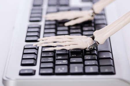 Skeleton working on the keyboard Stock Photo - 18311785