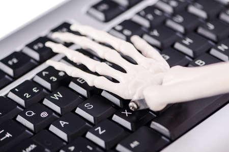 Skeleton working on the keyboard Stock Photo - 18311799