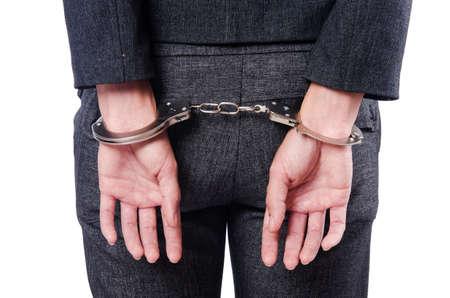 white collar crime: Female businesswoman with handcuffs on white