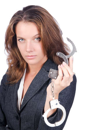 Female businesswoman with handcuffs on white photo