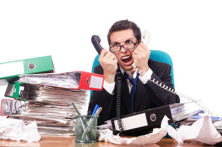Young busy businessman at his desk Stock Photo - 18654769