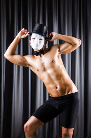 Muscular actor with mask against curtain Stock Photo - 18312045