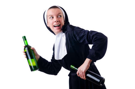 Nun with bottle of red wine Stock Photo - 18659874