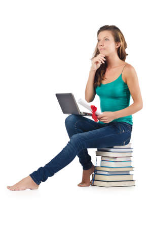 Student with netbook sitting on books Stock Photo - 18654833