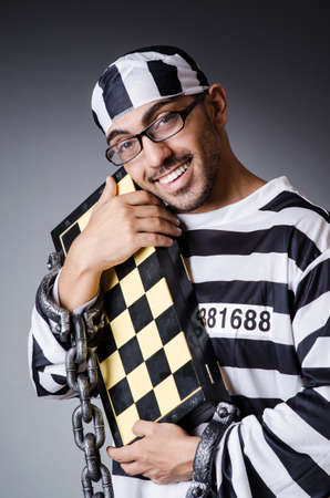 Convict criminal in striped uniform Stock Photo - 18663932