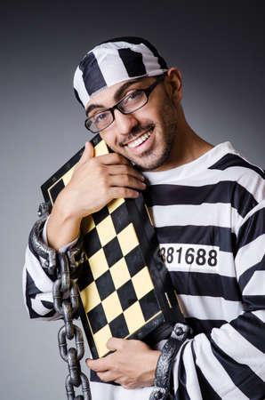 Convict criminal in striped uniform Stock Photo - 18663932