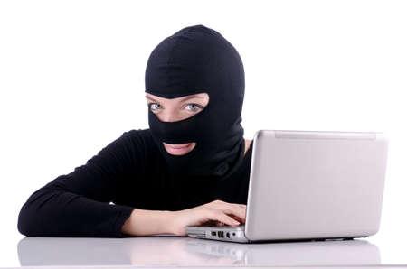 Hacker with computer wearing balaclava Stock Photo - 18663593
