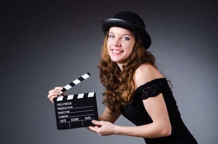 Woman with movie clapper board photo