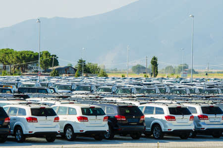 TUSCANY, ITALY - 27 June: New cars parked at distribution center in Tuscany, Italy. This one of biggest distribution centers in Italy. Stock Photo - 18509352
