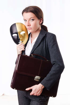 Woman with mask in hypocrisy concept Stock Photo - 18664050