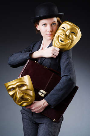 Woman with mask in hypocrisy concept Stock Photo - 18664065