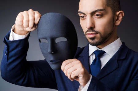 insincere: Man with black mask in studio