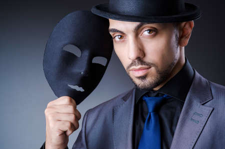 Man with black mask in studio Stock Photo - 18664072