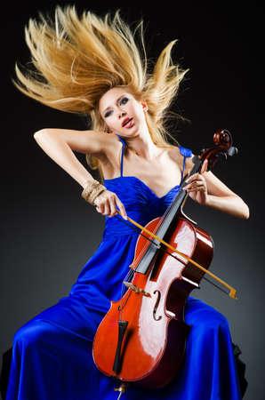 solo violinist: Attractive woman with cello in studio
