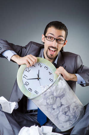 Man with clock and pile of papers Stock Photo - 18664759