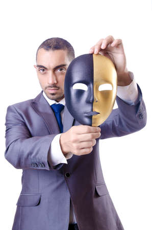 Businessman with mask in hypocrisy concept Stock Photo - 18664691