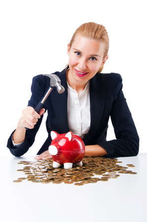 Woman breaking piggy bank for savings Stock Photo - 18664563