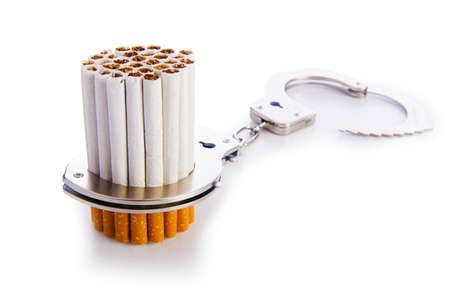 Addition concept with cigarettes and handcuffs Stock Photo - 18478046