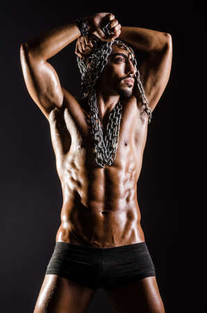 Muscular man with chain on black background Stock Photo - 18664740