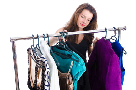 clothing rack: Woman trying new clothing on white Stock Photo