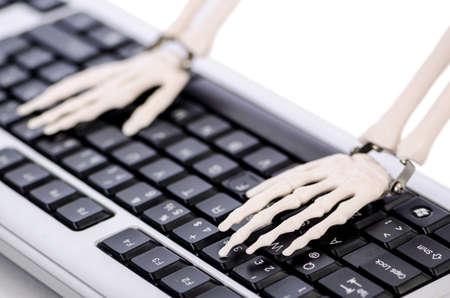 dreadful: Skeleton working on the keyboard