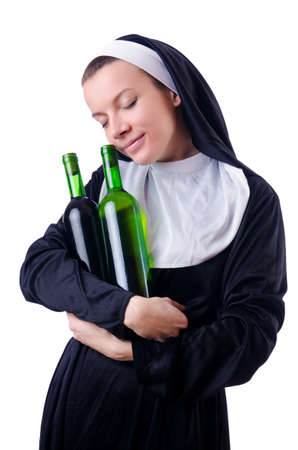 Nun with bottle of red wine Stock Photo - 18664626