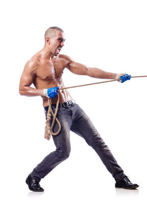 Muscular man pulling the rope photo
