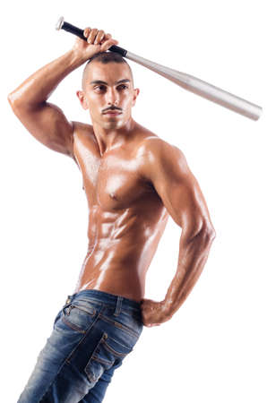 Muscular man with baseball bat on white photo